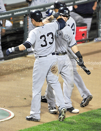 New York Yankees right fielder Nick Swisher (33) celebrates with teammate Russell Martin (55) after hitting a 2 run home run in the seventh inning against the Baltimore Orioles at Oriole Park at Camden Yards in Baltimore, MD on Friday, August 26, 2011.  The Orioles won the game 12 - 5..Credit: Ron Sachs / CNP.(RESTRICTION: NO New York or New Jersey Newspapers or newspapers within a 75 mile radius of New York City)