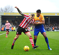 Lincoln City's Harry Anderson vies for possession with Mansfield Town's Malvind Benning<br /> <br /> Photographer Andrew Vaughan/CameraSport<br /> <br /> The EFL Sky Bet League Two - Lincoln City v Mansfield Town - Saturday 24th November 2018 - Sincil Bank - Lincoln<br /> <br /> World Copyright &copy; 2018 CameraSport. All rights reserved. 43 Linden Ave. Countesthorpe. Leicester. England. LE8 5PG - Tel: +44 (0) 116 277 4147 - admin@camerasport.com - www.camerasport.com