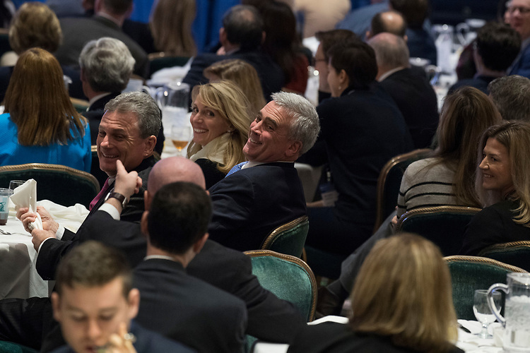 UNITED STATES - FEBRUARY 01: Rep. Brad Wenstrup, R-Ohio, center, attends a luncheon featuring a speech by President Donald Trump at the House and Senate Republican retreat at The Greenbrier resort in White Sulphur Springs, W.Va., on February 1, 2018. (Photo By Tom Williams/CQ Roll Call)