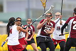 Santa Barbara, CA 02/19/11 - Angelica Acosta (Stanford #4), Amanda Rost (Stanford #18), Mia Divecha (Stanford #14) and Kali Samuelson (Minnesota-Duluth #26) in action during the Stanford - Minnesota-Duluth game at the 2011 Santa Barbara Shootout.