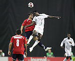 15 July 2007: Nigeria's Oladapo Olufemi (4) challenges for a header with a Chile player. Chile's Under-20 Men's National Team defeated Nigeria's Under-20 Men's National Team 4-0 after extra time in a  quarterfinal match at Olympic Stadium in Montreal, Quebec, Canada during the FIFA U-20 World Cup Canada 2007 tournament.