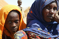 a mother and daughter wait to be registered as refugees in the Farchana refugee camp on Jan 2005 in Chad