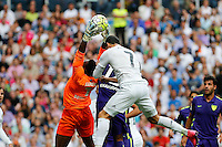 Real Madrid´s Cristiano Ronaldo and Malaga´s goalkeeper Kameni