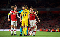 Referee Sandro Schärer holds back Kieran Tierney & Matteo Guendouzi of Arsenal from Mergim Vojvoda of Standard Liege during the UEFA Europa League match between Arsenal and Standard Liege at the Emirates Stadium, London, England on 3 October 2019. Photo by Andrew Aleks.