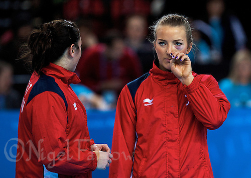 23 NOV 2011 - LONDON, GBR - Britain's Nina Heglund (right) talks with team mate Louise Jukes (left) whilst lined up before the start of their 2011 London Handball Cup match against Angola at The Handball Arena in the Olympic Park in Stratford, London .(PHOTO (C) NIGEL FARROW)