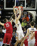 Iowa's Adam Woodbury (34) dunks the ball while being guarded by Davidson' s Osker Michelsen (15)  during 2015 NCAA Division I Men's Basketball Championship March 20, 2015 at the Key Arena in Seattle, Washington.  Iowa beat Davidson 83-52.   ©2015. Jim Bryant Photo. ALL RIGHTS RESERVED.