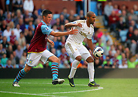 Saturday 15 September 2012<br /> Pictured: Luke Moore of Swansea (R) is challenged by Ciaran Clark of Aston Villa (L).<br /> Re: Barclay's Premier League, Aston Villa v Swansea City FC at Villa Park, West Midlands, UK.