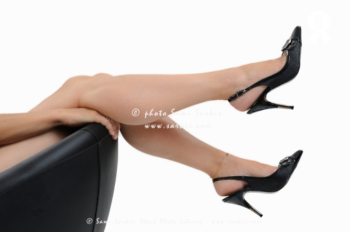 Nude woman's legs up with high heels (Licence this image exclusively with Getty: http://www.gettyimages.com/detail/103933321 )