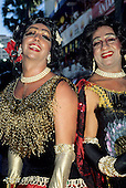 Salvador, Bahia, Brazil. Carnival; two transvestites dressed elaborately for the parade.