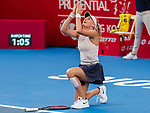 Dayana Yastremska of Ukraine celebrates after winning the singles final match against Wang Qiang of China at the WTA Prudential Hong Kong Tennis Open 2018 at the Victoria Park Tennis Stadium on 14 October 2018 in Hong Kong, Hong Kong.