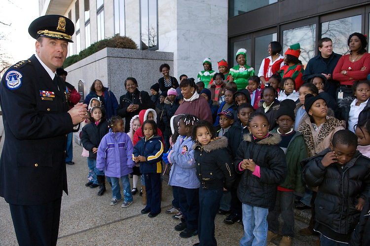 U.S. Capitol Police Chief Phillip Morse and kids  watch for Santa at the Hart Senate Office Building in Washington, D.C..The United States Capitol Police will hosted the 8th Annual Holiday Party for sixty Birney Elementary School children. The event took place in the Hart Senate Office Building.  During the event, children ages 4 through 11 where be transported by police escort motorcade from Birney Elementary School to Capitol Hill, where they will wait for Santa to arrive on horse and carriage. The children enjoyed refreshments, entertainment, and received gifts donated by members of the United States Capitol Police and area businesses.