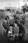Gypsy family camped at roadside,  casual seasonal fruit picking Wisbech Cambridgeshire Uk 1977.<br />