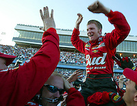 Dale Earnhardt, Jr., driver of No. 8 Chevy, celebrates with his crew at the start finish line after winning the Daytona 500, Sunday, February 15, 2004, at Daytona International Speedway in Daytona Beach, Fla. (AP Photo/Kelly Jordan, The Daytona Beach News-Journal)