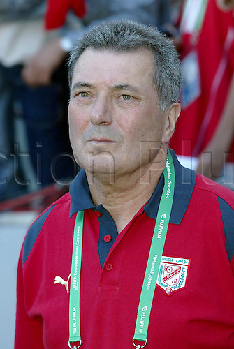 18 June 2005: Portrait of Tunisian coach Roger Lemerre standing by the dug-out before the FIFA Confederations Cup Group A game between Tunisia and Germany played at the RheinEnergie Stadion, Cologne, Germany. Germany won the match 3-0. Photo: Neil Tingle/actionplus..050618 football soccer koln manager coach coaches