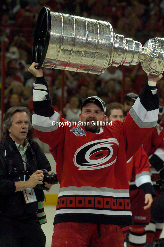Cory Stillman holds the Stanley Cup after the Carolina Hurricanes beat the Edmonton Oilers 3-1 in game seven to win the series at the RBC Center in Raleigh, NC Monday, June 19, 2006.