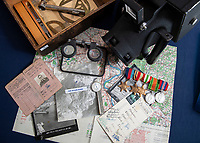 BNPS.co.uk (01202 558833)<br /> Pic: PhilYeomans/BNPS<br /> <br /> Unearthed - fascinating unseen archive of cameras, photographs, documents and medals from a British aerial reconnaisance expert who fought all the way through Africa and southern Europe in WW2.<br /> <br /> Flt Lt Eric Cooper from London kept all his wartime paraphernalia, including his K20 handheld camera and stereoscopic plotting instruments until his death in Devon aged 96 in 2012.<br /> <br /> The incredible photographs show bombing raids, amphibious landings and badly damaged aircraft alongside off duty snaps of the campaign throughout the mediterraenean.<br /> <br /> His nephew is now selling the compelling collection at Plymouth Auction Rooms in Devon next week.