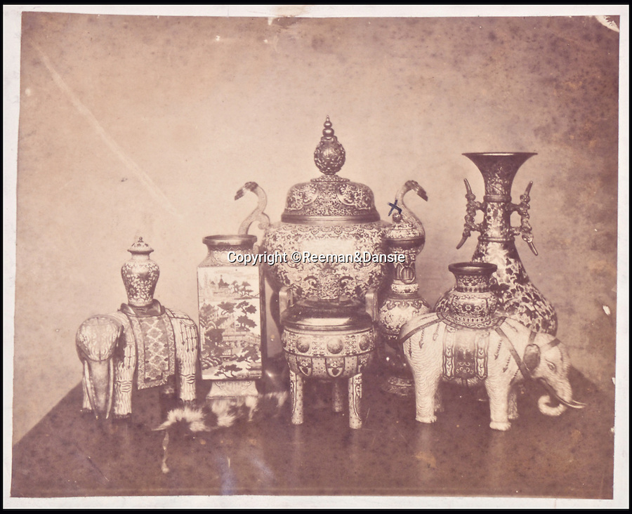 BNPS.co.uk (01202 558833)<br /> Pic: Reeman&Dansie/BNPS<br /> <br /> Rare photos showing some of the precious antiques looted from China's Summer Palace 156 years ago which Asian millionaires are today buying back in their droves have come to light.<br /> <br /> The images, taken by celebrated photographer Felice Beato soon after the theft, depict Ming vases, pots and bowls made for the Chinese emperor to display at the Imperial palace in Peking.<br /> <br /> The mystical building was partially destroyed by the British and French and its wealth of contents seized and taken to Europe at the end of the Second Chinese Opium War in 1860.<br /> <br /> The beautiful pieces of porcelain are the very objects the newly-rich Chinese are paying British auction houses millions of pounds for now as they attempt to buy back their lost heritage.