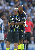 Manchester City's Vincent Kompany (right) hands on the captaincy to Manchester City's Sergio Aguero (right) <br /> <br /> Photographer David Horton/CameraSport<br /> <br /> The Premier League - Brighton and Hove Albion v Manchester City - Sunday 12th May 2019 - The Amex Stadium - Brighton<br /> <br /> World Copyright © 2019 CameraSport. All rights reserved. 43 Linden Ave. Countesthorpe. Leicester. England. LE8 5PG - Tel: +44 (0) 116 277 4147 - admin@camerasport.com - www.camerasport.com