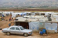 LEBANON Baalbek in Beqaa valley, syrian refugee camp, UNHCR tents and german Mercedes Benz car  / LIBANON Baalbek in der Bekaa Ebene, syrisches Fluechtlingslager, UNHCR Zelte und deutsches Mercedes Benz Auto