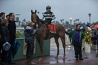 ARCADIA, CA  MARCH 10:   #7 Accelerate, ridden by Victor Espinoza, in the winners circle after winning the Santa Anita Handicap (Grade l) on March 10, 2018, at Santa Anita Park in Arcadia, CA. (Photo by Casey Phillips/ Eclipse Sportswire/ Getty Images)