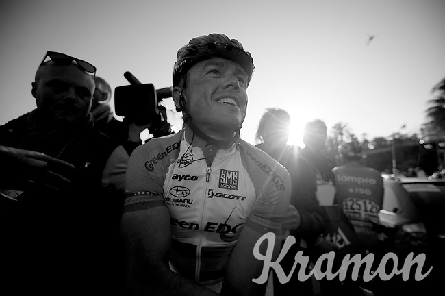 Milan-San Remo 2012.raceday.winner Simon Gerrans happily on his way to the podium