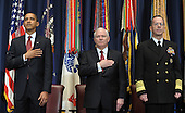 Washington, DC - March 12, 2009 -- United States President Barack Obama, Secretary of Defense Robert Gates and Chairman of the Joint Chiefs of Staff Adm. Michael Mullen (L to R) listen as the National Anthem is played during the dedication of the Abraham Lincoln Hall at the National Defense University at Ft. McNair in Washington on Thursday, March 12, 2009.   .Credit: Roger L. Wollenberg - Pool via CNP