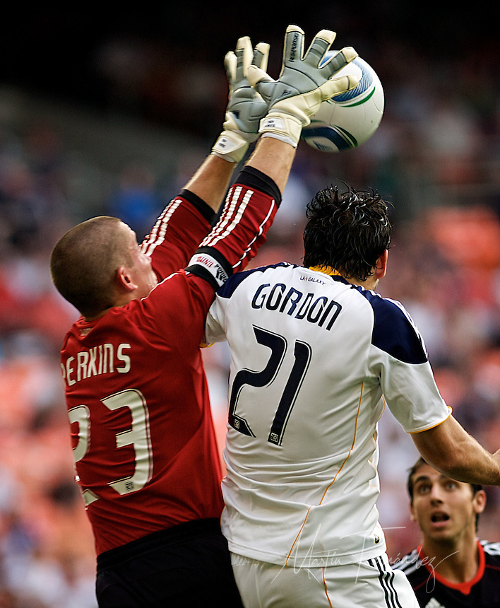 Troy Perkins reaches over LA's Alan Gordon. DC United continued their abysmal season with a 2-1 home loss to the visiting LA Galaxy at RFK Stadium in Washington DC.