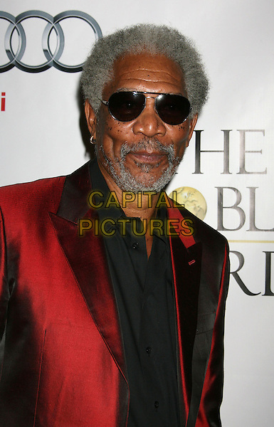 MORGAN FREEMAN .1st Annual Noble Humanitarian Awards - Arrivals held at the Beverly Hilton, Beverly Hills, California, USA, .18th October 2009..portrait headshot sunglasses aviators  red shiny jacket black shirt beard goatee facial hair .CAP/ADM/MJ.©Michael Jade/AdMedia/Capital Pictures.