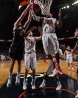 Virginia forward Akil Mitchell (25) grabs a rebound during the game Saturday, February 22, 2014,  in Charlottesville, VA. Virginia won 70-49.