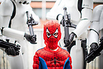 © Joel Goodman - 07973 332324. 30/07/2017 . Manchester , UK . Spiderman (Joseph Hughes, five from Heaton Mersey) , surrounded by Storm Troopers . Cosplayers, families and guests at Comic Con at the Manchester Central Convention Centre . Photo credit : Joel Goodman