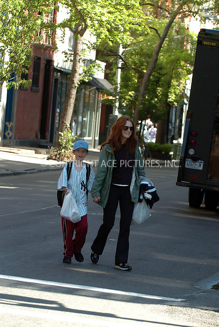 WWW.ACEPIXS.COM ** ** **EXCLUSIVE!!! FEE MUST BE NEGOTIATED BEFORE USE!!!***....NEW YORK, MAY 9, 2005....Julianne Moore takes her son walking through the West Village on a beautiful spring day.....Please byline: Philip Vaughan -- ACE PICTURES... *** ***  ..Ace Pictures, Inc:  ..Craig Ashby (212) 243-8787..e-mail: picturedesk@acepixs.com..web: http://www.acepixs.com