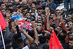 Mourners carry the body of Palestinian Omar al-Badawi, 22,  who was killed during clashes with Israeli security forces in the al-Arroub refugee camp north of the West Bank city of Hebron on November 11, 2019. Photo by Mosab Shawer