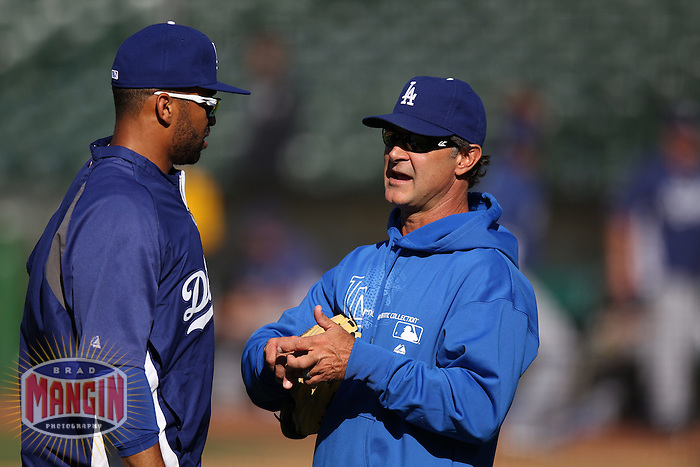 OAKLAND, CA - JUNE 19:  Matt Kemp #27 and manager Don Mattingly #8 of the Los Angeles Dodgers talk during batting practice before the game against the Oakland Athletics at O.co Coliseum on Tuesday June 19, 2012 in Oakland, California. Photo by Brad Mangin