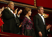 United States President George W. Bush (R) and First Lady Laura Bush (2nd R) attend an honor gala with actor James Earl Jones, one of the recipients of the 2002 Kennedy Center Honors December 8, 2002 at the Kennedy Center in Washington, DC. The Kennedy Center honored the recipients of the 2002 Kennedy Center Honors for their contributions to the cultural life of the nation..Credit: Alex Wong / Pool via CNP
