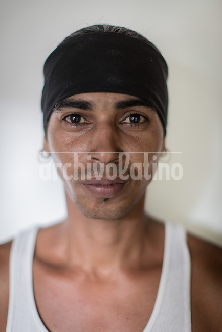 Cuban janitor Adrian Lorente Parra .Once more Cubans are experimenting deep turns in their scattered economy. A photo essay by Lorenzo Moscia with available story by Colette Rodriguez Marcano.las calles de La Habana con humorismo y ganas de vivir.
