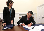 Chief of Staff Heidi Gansert looks on as Nevada Gov. Brian Sandoval signs several executive orders immediately following Monday's inauguration, Jan. 3, 2011 at the Capitol in Carson City, Nev. <br /> Photo by Cathleen Allison