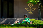 May 8, 2018; Undergraduate student Brandon Hardy sits by the library reflecting pool. (Photo by Matt Cashore/University of Notre Dame)
