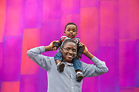 Man giving his son shoulder ride by the EMP Museum, Northwest Folklife Festival 2016, Seattle Center, Washington, USA.