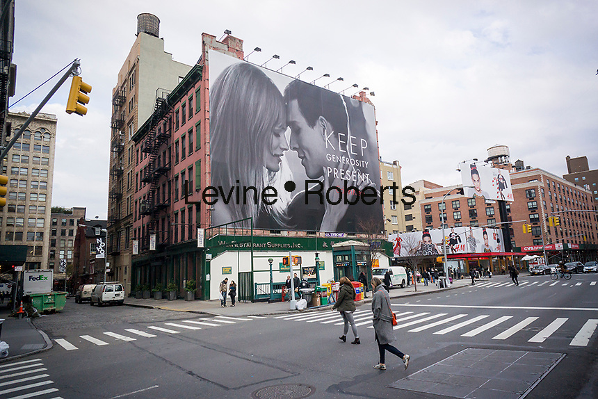 A Calvin Klein billboard in the Soho neighborhood of New York on Friday, December 19, 2015 provides a secular take on the holiday season promoting gift giving. The advertisement is a contrast to the company's usual sexy billboard. (© Richard B. Levine)
