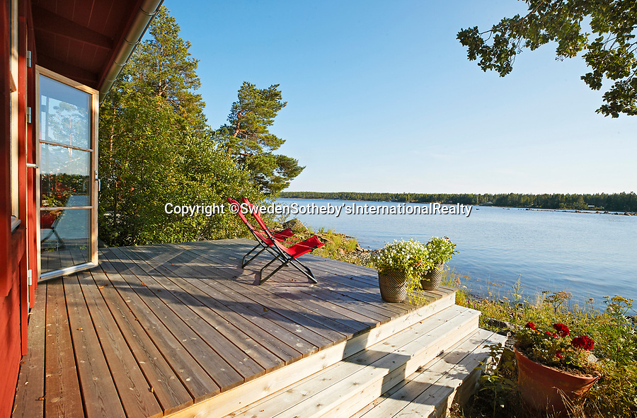 BNPS.co.uk (01202 558833)<br /> Pic: SwedenSotheby's/BNPS<br /> <br /> The view from cabins are fantastic<br /> <br /> A stunning private Swedish island has emerged on to the market for £1.2million ($1.4m) -  the same price as a terraced house in London.<br /> <br /> Gasharsskaret is a 0.27 acre island with flat rock cliffs, sandy beaches and open grassy areas. It is located about 100 yards from the Swedish mainland in the Soderhamn archipelago on the east coast of the country.<br /> <br /> A cluster of cabins have been built on the island, including a main house, a guest house, a beach house and a sauna. It also boasts a wooden hot tub and a landing area for a helicopter.<br /> <br /> The estate agent, Sothebys Realty, say it would be the ideal setting for a large family and could be used for 'retreats and conferences'.