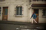 An African migrant who just crossed the Spanish French border walks through the streets heading to the train station. Hendaia (Basque Country). January 26, 2019. As the number of migrants arriving on the coasts of southern Spain incresead, more and more migrants are heading north to the border city of Irun. (Gari Garaialde / Bostok Photo)