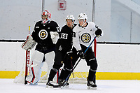 June 28, 2018: Boston Bruins defenseman Victor Berglund (64) and forward Jack Becker (72) work in front of the net protected by goalie Kyle Kyser (85) during the Boston Bruins development camp held at Warrior Ice Arena in Brighton Mass. Eric Canha/CSM