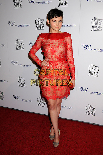 GINNIFER GOODWIN .24th Annual Genesis Awards - Arrivals held at the Beverly Hilton Hotel, Beverly Hills, California, USA, 20th March 2010..full length red lace dress long sleeved sleeves clutch bag grey gray beige shoes platform hand on hip ruffle neck .CAP/ADM/BP.©Byron Purvis/AdMedia/Capital Pictures.