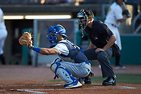 Lexington Legends catcher MJ Melendez (7) catches a pitch as home plate umpire Kelvis Velez looks on during the game against the West Virginia Power at Appalachian Power Park on June 7, 2018 in Charleston, West Virginia. The Power defeated the Legends 5-1. (Brian Westerholt/Four Seam Images)