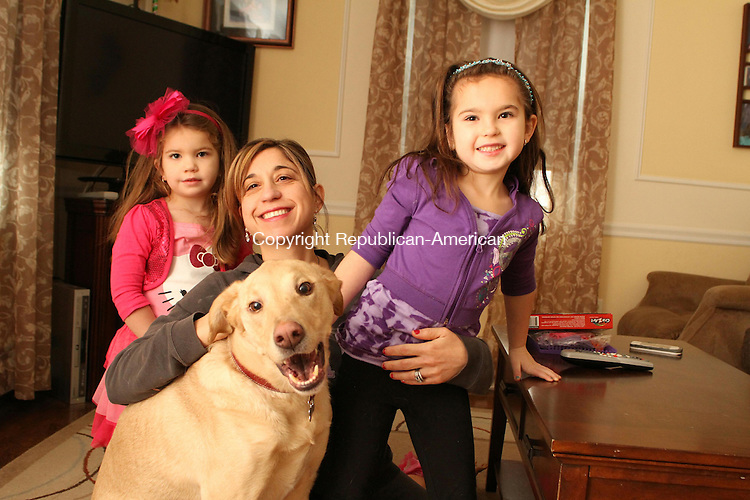 WATERBURY, CT-26 December 2013-122613LW01 - Carol Coffey, center, poses with her daughters, Peyton, 3, left, and Addison, 6, and their dog, Max. Max went missing for two weeks in August after he was hit by a car, but was reunited with his family. <br />