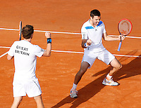 Britain's Andy Murray (L) and his teammate Colin Fleming celebrate after winning their Davis Cup quarter-final doubles tennis match against Italy's Fabio Fognini and Simone Bolelli in Naples April 5, 2014.