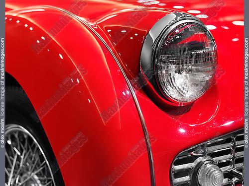Red 1959 Triumph TR3A classic retro car closeup  of details