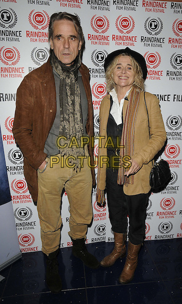 Jeremy Irons & Sinead Cusack.attended the 'Trashed' official screening, Raindance Film Festival, Apollo cinema, Regent St., London, England, UK, .29th September 2012..full length brown leather jacket  scarf beige trousers camel coat  boots .CAP/CAN.©Can Nguyen/Capital Pictures.