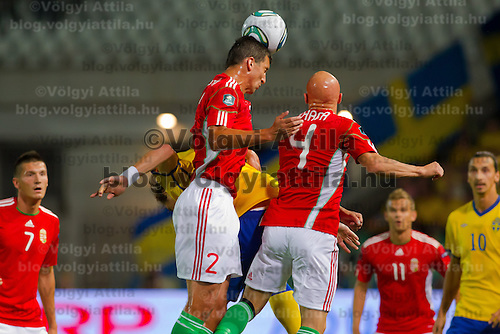 Hungary's Zoltan Liptak (L) and Jozsef Varga (R) jump for a header during the UEFA EURO 2012 Group E qualifier Hungary playing against Sweden in Budapest, Hungary on September 02, 2011. ATTILA VOLGYI