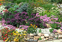 Annual and perennial flower garden lined with a rock border.  Edina Minnesota USA